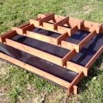 Pyramide jardinière faite avec des palettes pour votre jardin