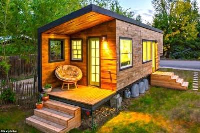 Maison construite avec des planches de palettes en bois pour moins de € 10,000 ( $ 12,000 )