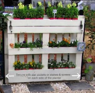 instructions pour faire un planteur cl ture avec palettes pour votre jardinmeuble en palette. Black Bedroom Furniture Sets. Home Design Ideas