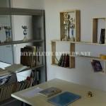 Design d'étagère construit avec des palettes planches
